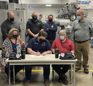 New employee signing day at Magna Machine and Tool